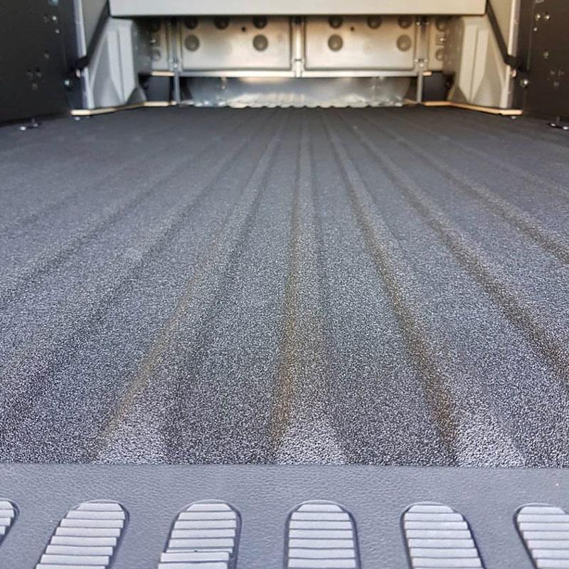 Защита фургона для перевозки древесины покрытием Line-X